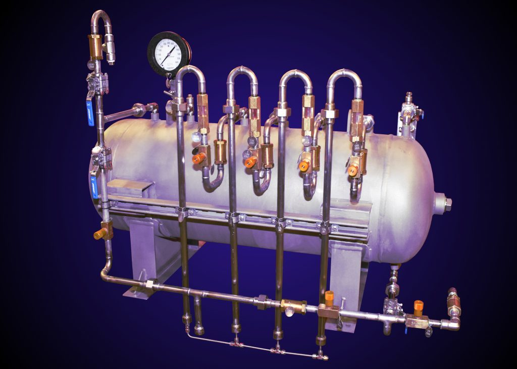 This is a horizontal pressure vessel that has been outfitted with stainless steel piping, valves and fittings.